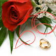 Wedding rings and rose — Stock Photo #1464756