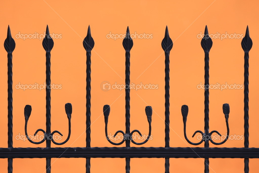 Black fence silhouette on orange background — Stock Photo #1464227