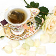 Cup of tea with white rose — Stock Photo #1739463