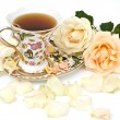Cup of tea with white rose - Stock Photo