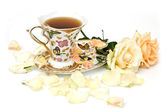 Cup of tea with white rose — Stock Photo