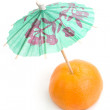 Mandarin with umbrella on white backgrou — Stock Photo