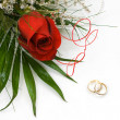 Stock Photo: Wedding rings and rose