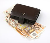 Wallet over money — Stock Photo