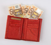 Cartera roja con billetes de euros — Foto de Stock