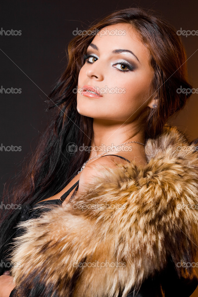 Beautiful fashionable woman with fur  Foto de Stock   #1390373