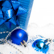 Festive balls with gift box on snow — Stock Photo