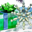 Green gift box with Christmas star — Stock Photo