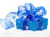 Gift box on white snow — Stock Photo