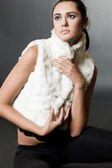 Woman in a fur waistcoat — Stock Photo