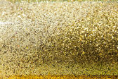 Glitter sparkles dust on background — Stock Photo