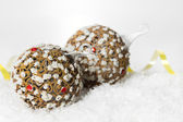 Festive decoration on white snow — Stock Photo