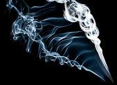 Blue smoke on black background — Stock Photo