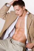 Attractive man in beige jacket — Stock Photo