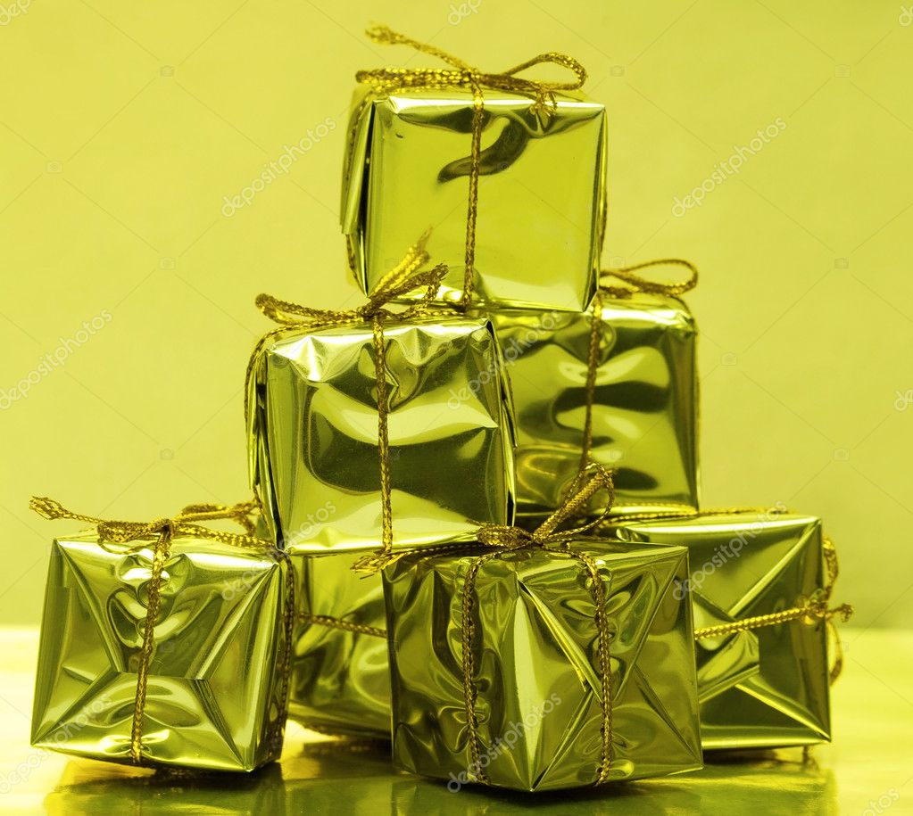 Stack of golden gift boxes  — Stock Photo #1401524