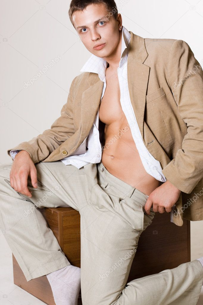 Attractive man in beige jacket — Stock Photo #1406899
