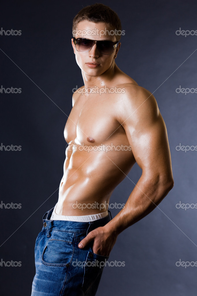 Young bodybuilder man on black background — Stock Photo #1406974