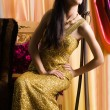 Sexy fashionable woman in golden dress — Stock Photo #1414042