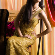 Stock Photo: Sexy fashionable woman in golden dress