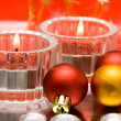 Festive candles with Christmas balls - Stock Photo
