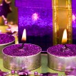 Violet gift box and burning candle - Zdjęcie stockowe