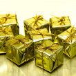 Gift boxes on golden background — ストック写真