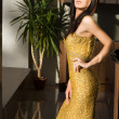Stock Photo: Woman in golden dress