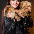 Stock Photo: Beautiful fashionable womwith fur