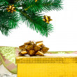Yellow gift box with Christmas tree — Stock Photo