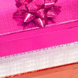 Varicoloured gift boxes with bow — Stock Photo #1417737