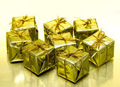 Gift boxes on golden background — Stock fotografie