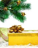 Yellow gift box with Christmas tree — Stock Photo