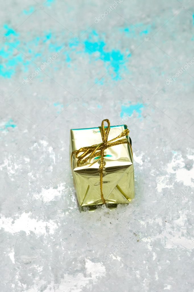 Golden gift box on snow   Stock Photo #1414969