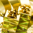 Golden gift boxes with ribbon — Stock Photo