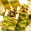 Stock Photo: Golden gift boxes with ribbon