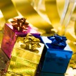 Gift boxes with golden ribbon — Stock Photo