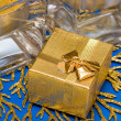 Golden present with candle - Foto Stock