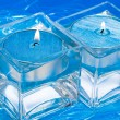 Blue candles in glass with water — Stockfoto