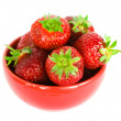 Strawberry on red plate — Stockfoto