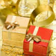 Gift boxes with golden ribbon — Stockfoto