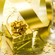 Golden gift box with ribbon - Stock Photo