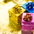Stock Photo: Gift boxes with gold ribbon