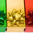 图库照片: Varicoloured gift boxes with bow