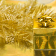 Gold gift box with Christmas tree — Stock Photo