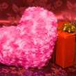 Gift box with pink heart — Stock Photo