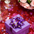 Gift box with bow and glass — Stock Photo