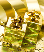 Golden gift boxes with ribbon — Stock fotografie