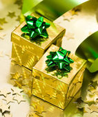 Golden gift box with ribbon — Stock Photo