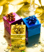Gift boxes with gold ribbon — Stock Photo