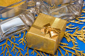 Golden present with candle — Stock Photo